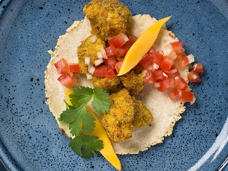 Crispy coconut and curry cauliflower with tomato salsa