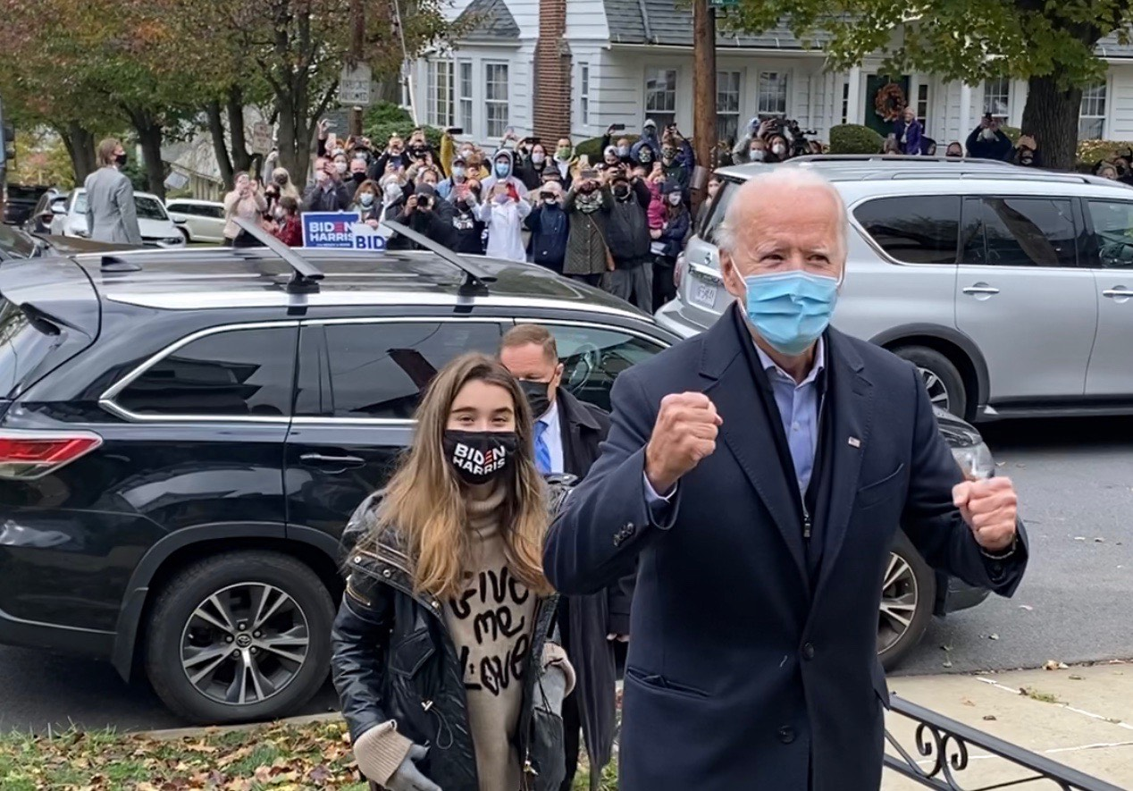 A fired up Joe Biden, with his granddaughter Natalie, approaches his childhood home.