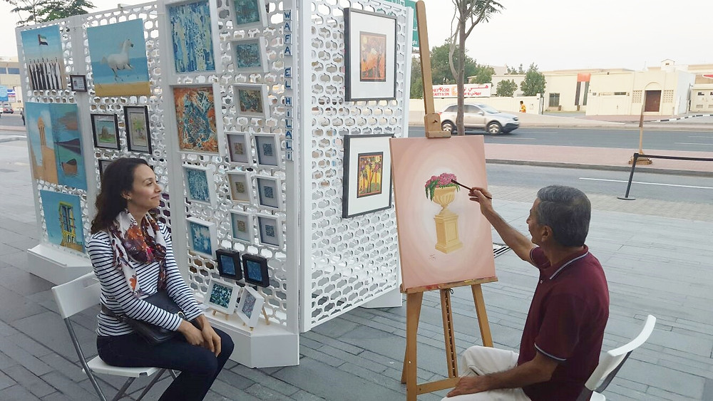 With Ahmed Rukni making my portrait ;-))