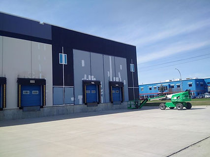 Exterior Painting Of Large wearhouse Commercial Painters