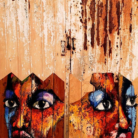 eyes of African people painted on a wooden wall