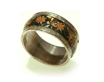 Black ring with orange flowers orbited gold dots