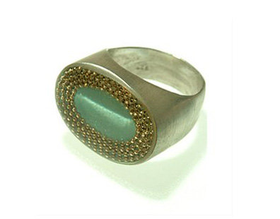 Green oval ring with gold dots