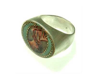 Green oval ring with deer
