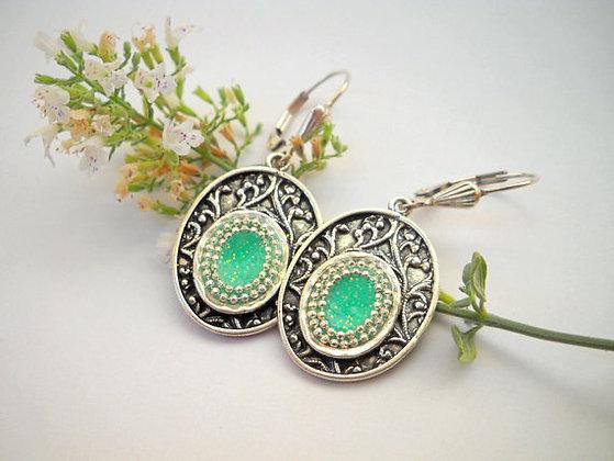 Oxidized sterling silver earrings, green center