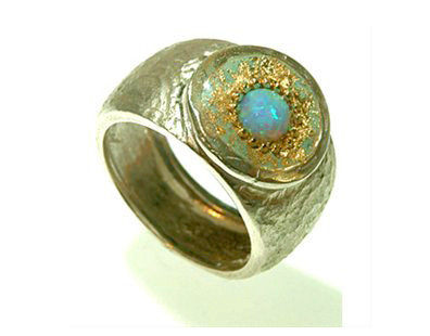 Green oval ring with opal stone