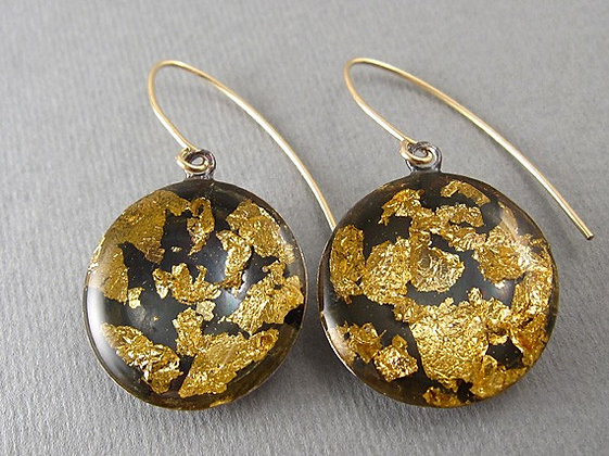 Round black earrings with gold foil