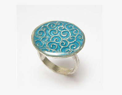 Oval ring with blue top and silver spirals