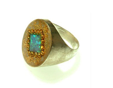 Oval ring with square opal stone