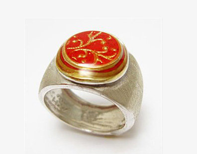 Red circle ring with gold filigree
