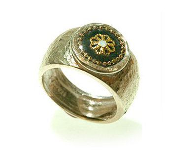Oval ring with gold flower and zircon