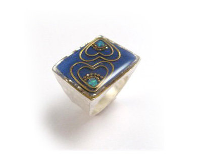 Square ring with gold hearts and opal stone
