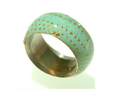 Mint green ring with gold dots orbit