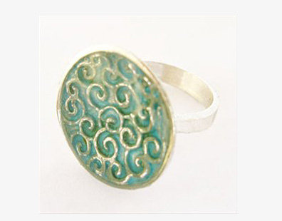 Aqua blue oval ring with spirals