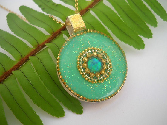 Mint green pendant with sparkly dots