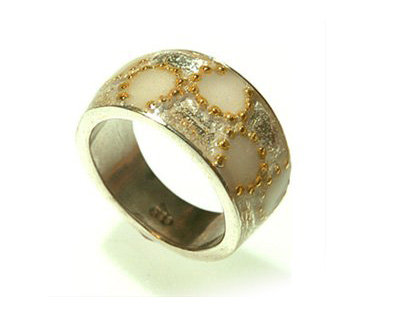 Silver ring with white flowers orbited gold dots