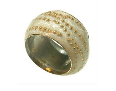 White ring with gold dots