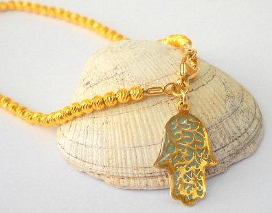 Beads bracelet with filigree Hamsa