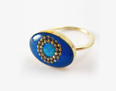 Blue oval shaped ring with opal stone