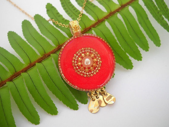 Red & Gold dangling pendant with a pearl