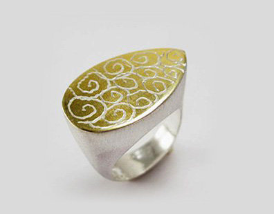 Tear shape ring engraved with spirals shapes