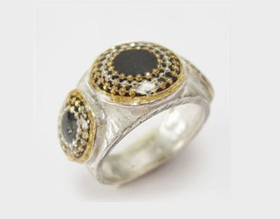 Silver ring with black circles
