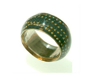 Dark green ring with gold dots orbit