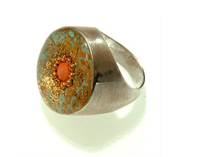 Green oval ring with gold foil and coral