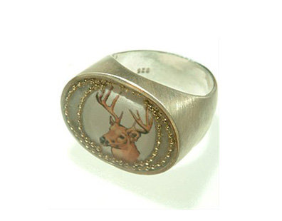 Silver oval ring with a deer