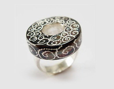 Silver and black ring with spirals