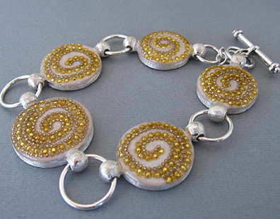 white circles with gold spirals