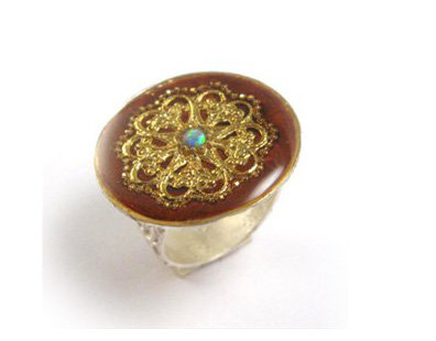 Round brown ring with gold flower and opal stone