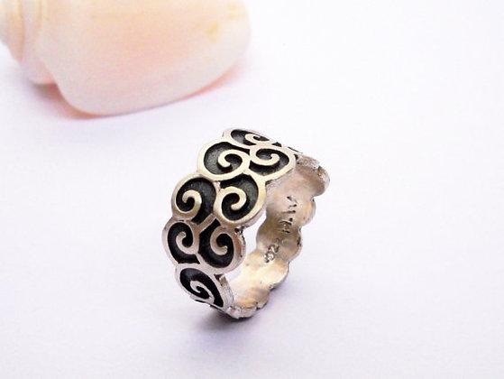 Silver spirals or dark waves Ring