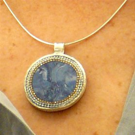 Sterling silver necklace. Blue pendant.