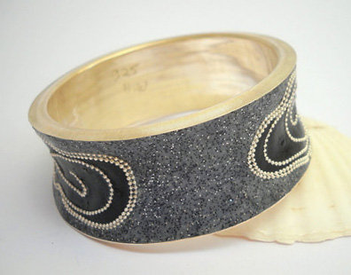 Black spirals in doty gray bracelet.