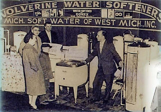 Photo from the 60's of family purchasing a water softener from wolverine
