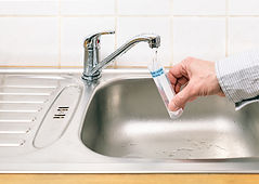 taking a water sample from sink