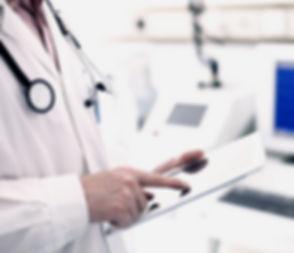 Doctor Using Digital Tablet_edited_edited.jpg