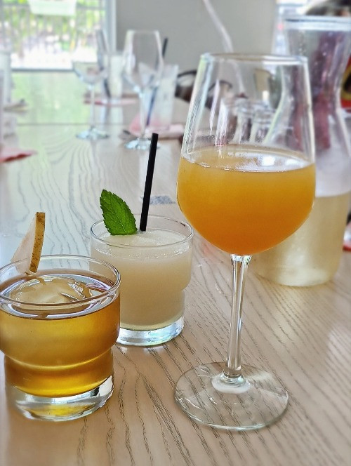 Brunch cocktails at Krio Dallas. Mimosa, Umami Old Fashioned, and the Lost City.