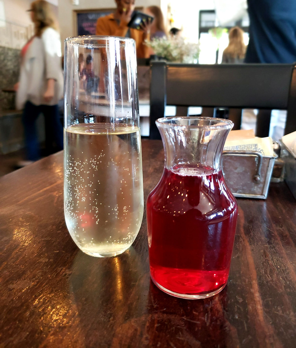 A glass of Prosecco with a side of cranberry juice. Can't beat this combination.