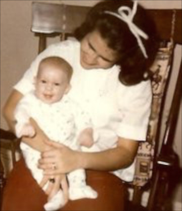 Mom holds me in a rocking chair on the day in October 1969 that she and Dad brought me home from the adoption agency.