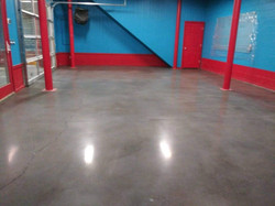 Polished concrete with gray dye.