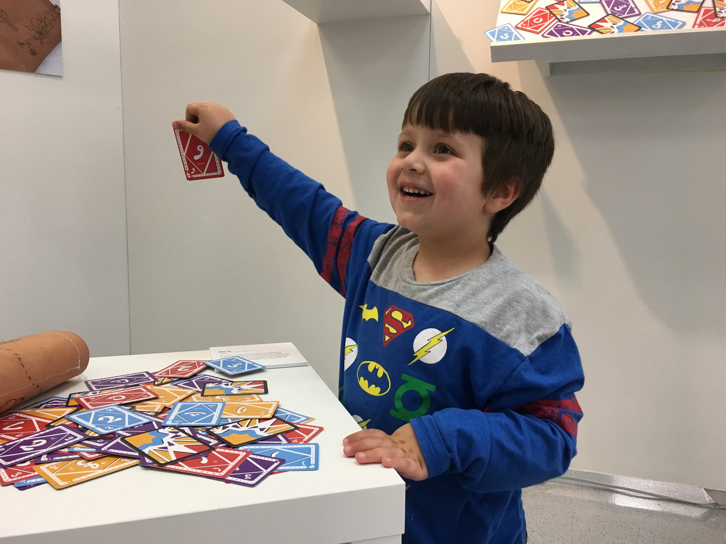 Kid Holding Card Game