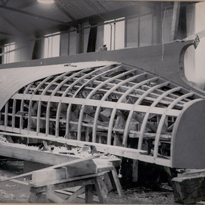 A vessel under construction by Chelsea Yacht & Boat Company at Cheyne Pier in the early 1940's