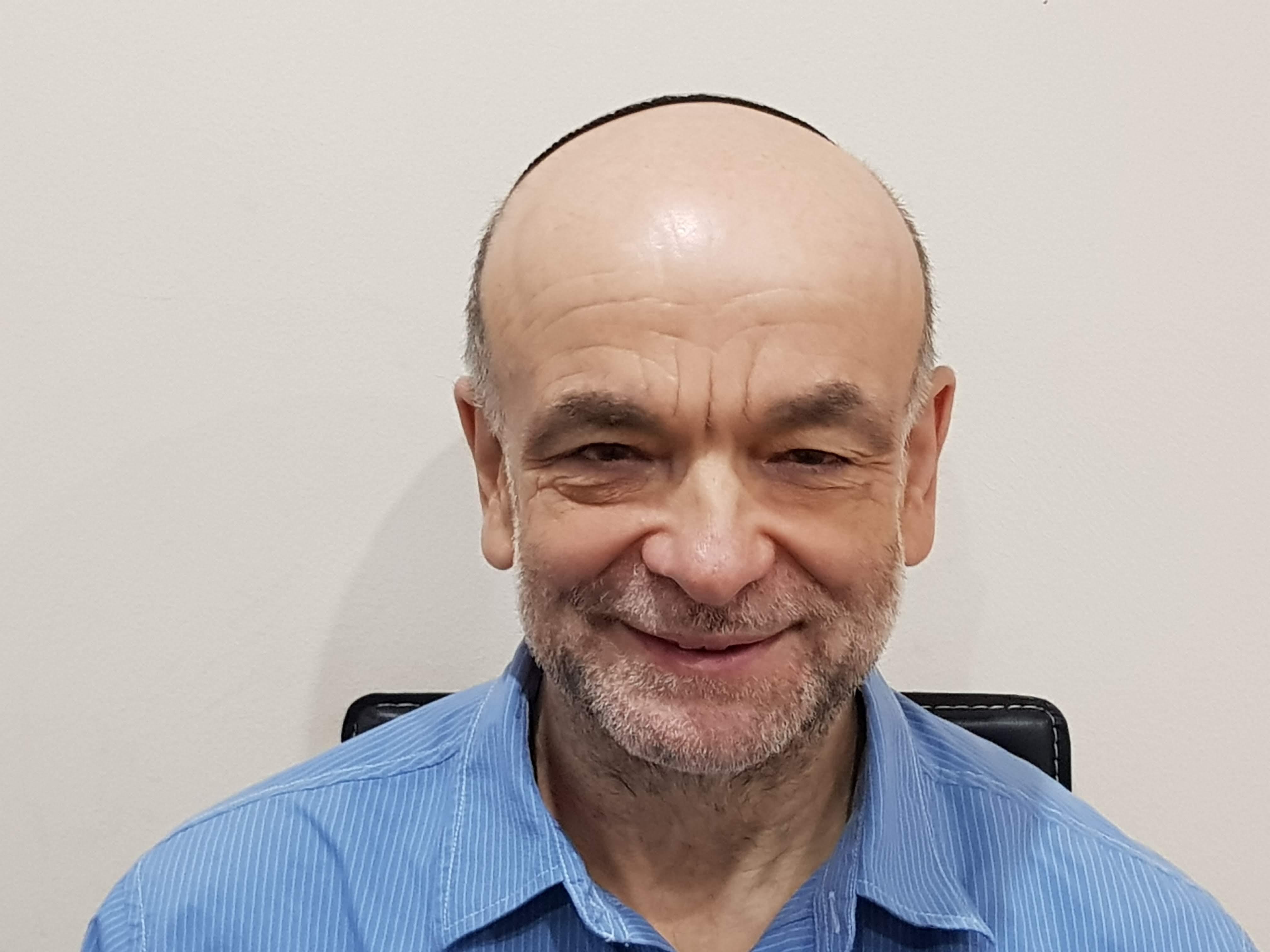 Prof Malcolm Granat