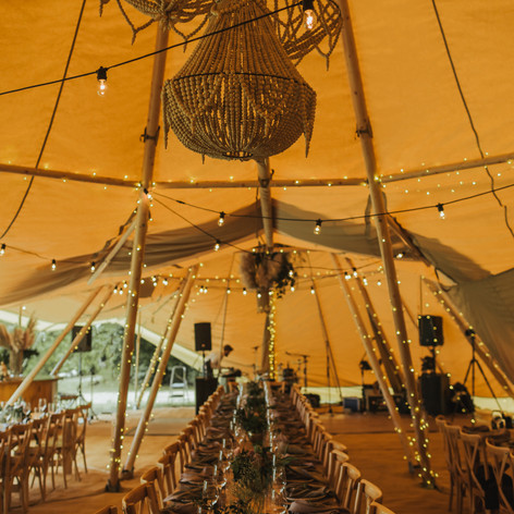 Tipis - festoons - matting - dance floor - round bar