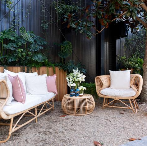 Gelung sofa - gelung armchair - niluh table - pink velvet stool - natural & pink linen cushions