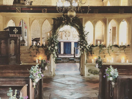 Mini Arches Dressed with Greenery and Candles