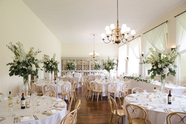 Tall stands, holding larger flower designs. Candles say romance, so it's no wonder that they have a place on the wedding table. Votives with tea lights add a glow amid large floral arrangements.