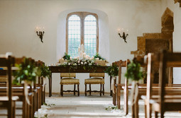 Winter Wedding; Stunning Candle design in the Altar Window